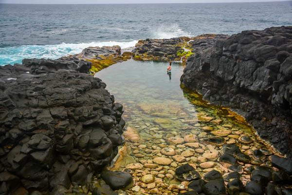 Swimming in Queen's Bath Kauai, Hawaii