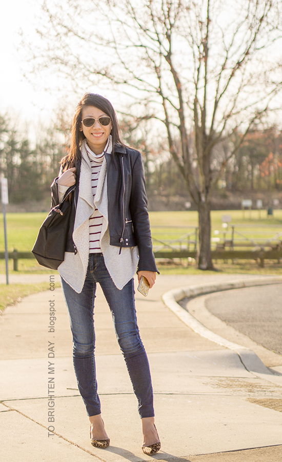 black leather jacket, sherpa-lined open cardigan sweater, burgundy striped turtleneck, skinny jeans, leopard pumps