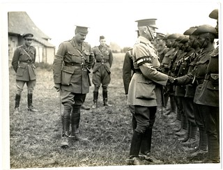 The General [Sir James Willcocks] talking to Indian officers at an inspection parade [near Merville, France]. Photographer: H. D. Girdwood. | by The British Library