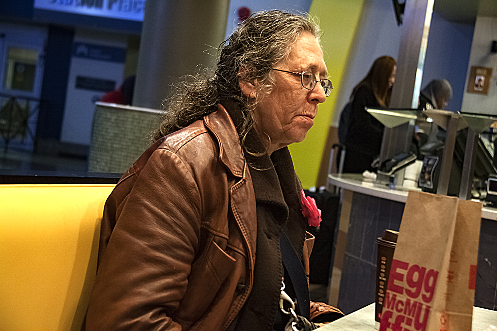 Woman sitting by herself in McDonald's at Union Station--Washington