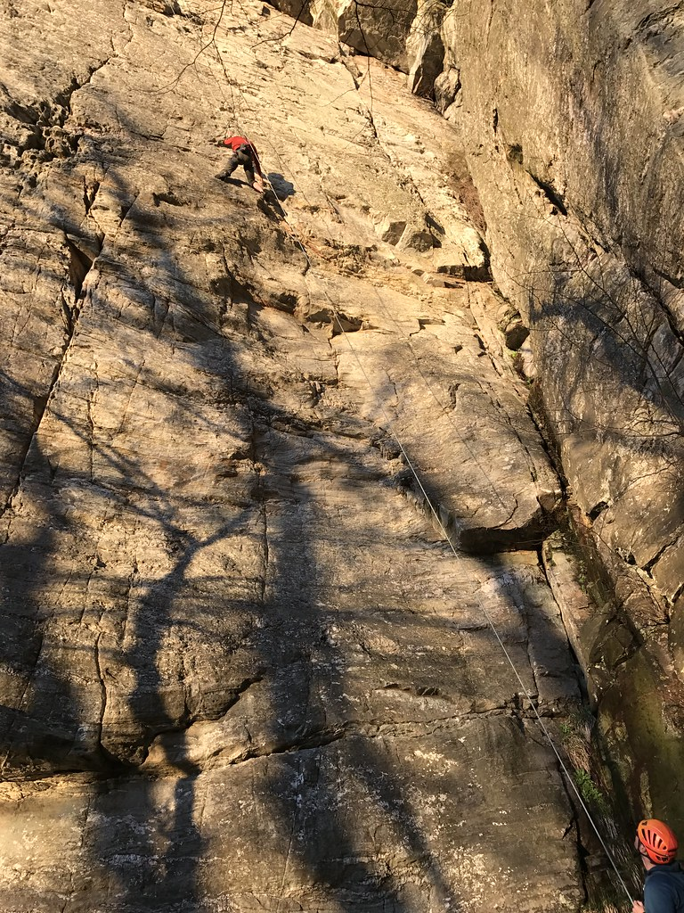 A climber sets a directional while descending