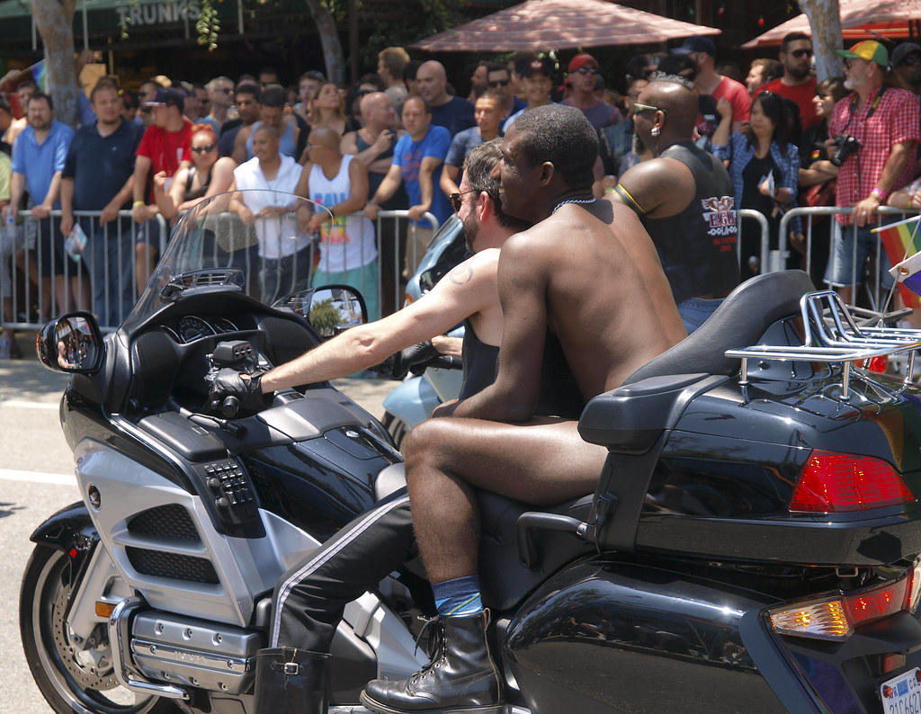 Naked man and motorcycle