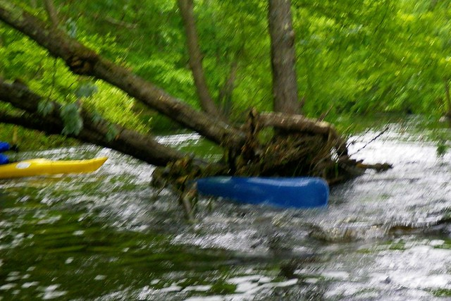 Another pinned boat from Saturday's flood