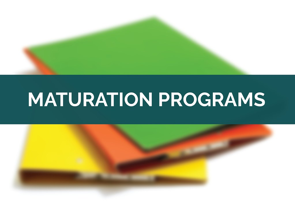 Stack of folders with text 'Maturation Programs'