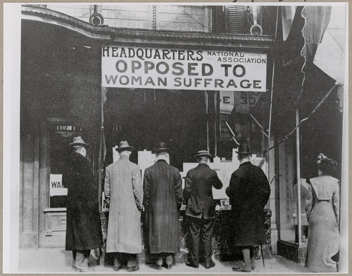 Passers-By Looking at Window Display at the Headquarters of National Association Opposed to Woman Suffrage, ca. 1919 | by The U.S. National Archives