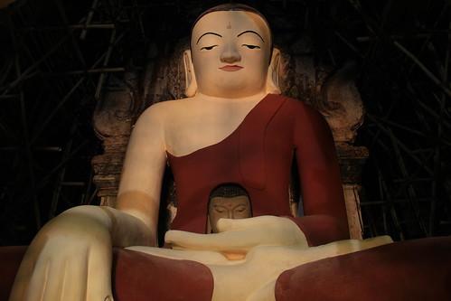 Buddha statue cradling Buddha head