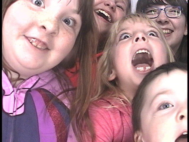 The kids in the photo booth at Cosi with Haylee