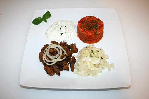 70 - Home made Gyros with tzatziki, tomato rice & cole slaw - Served / Hausgemachtes Gyros mit Tzatziki, Djuvecreis & Krautsalat - Serviert