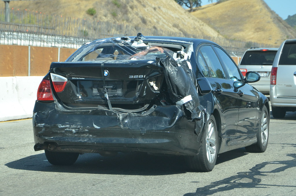 wrecked bmw 328i held together with cargo straps and duct flickr