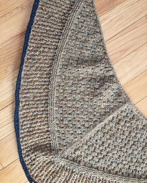 """Obligatory """"before blocking"""" picture. This shawl is full of bees 🐝 🐝🐝🐝🐝🐝🐝. I mean, beads. 💎💎💎💎💎💎💎."""