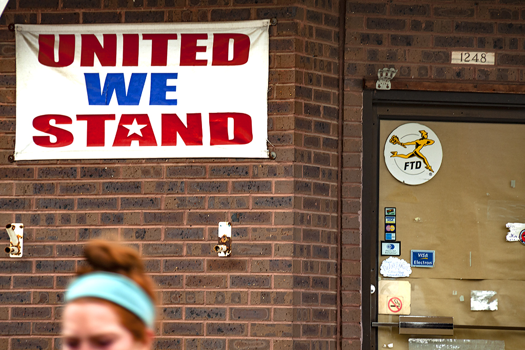 UNITED WE STAND banner on out of business flower shop--Passyunk Square