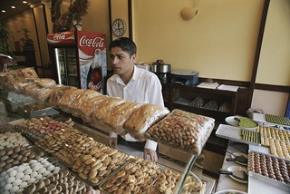 Attendant in bakery store | by World Bank Photo Collection