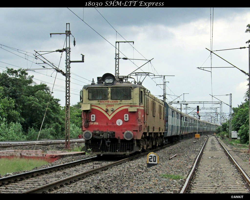 ... 18030 SHM-LTT Express cruising towards Nalpur station with BSL WAM-4  21309 at