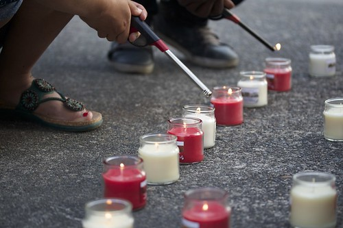 The Nepalese Student Association (NSA) holds a candle lit vigil on the UW's red square in Seattle