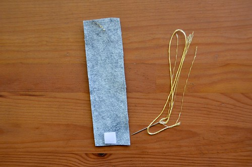 6. Flip felt strip over & reknot end of thread.