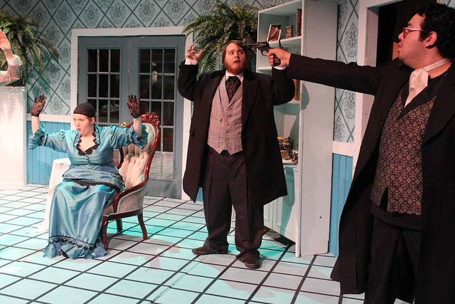 Josh Figueroa as Saul holds a gun on Bryan Rivera as Henry and Abigail Vernier as Violet in Play On!