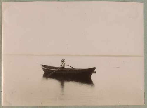 Naine aerupaadiga merel / A woman with a rowing boat on sea | by National Archives of Estonia