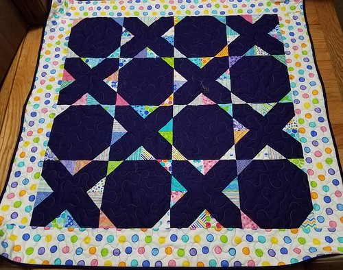 Hugs and Kisses Bright baby quilt is done.
