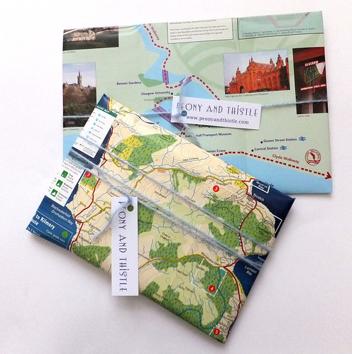 Wrapping with tourist brochures | by peonyandthistle