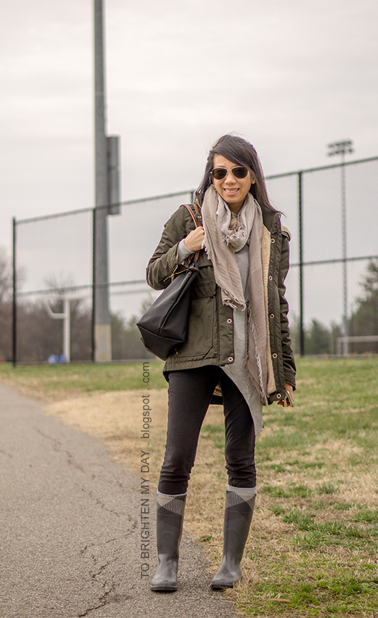 olive green parka, plaid scarf, gray asymmetric top, black skinny jeans, plaid rain boots