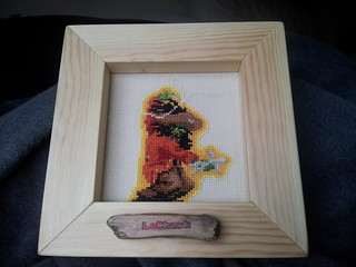 Nearly finished LeChuck cross-stitch + frame, button and electronics | by lilspikey