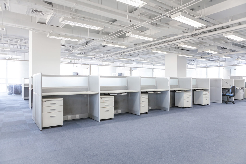 empty cubicles in a modern office building by foxcamera