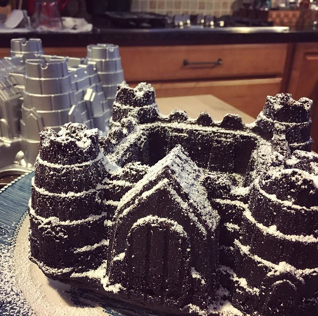 Chocolate castle cake with powdered sugar snow. Next time I'll make red velvet and it can be a Corps castle. #baking #yearofthebundt
