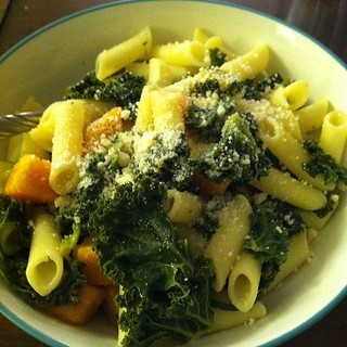 Kale, sweet potato, zucchini, onions, penne rice pasta, and Parmesan in a lemon butter garlic sauce. | by Sholeh