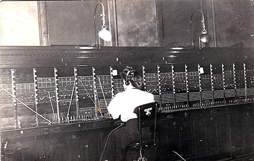 Telephone operator and switchboard, Kalamazoo, Michigan. RPPC, Postmarked 1908. | by Wystan