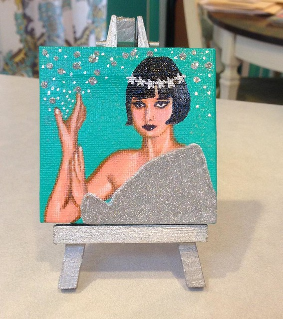 I've started a new line of miniature dollhouse paintings! Each one comes with a tiny easel that I handpaint/hand-glitter. First up is Louise Brooks! Check out my Etsy shop for details, http://ift.tt/1vbQsot 🌟✨✨