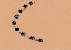 クラフト紙39_砂地を歩く黒プレーン