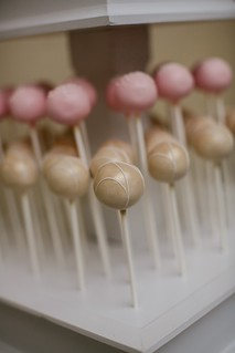 Gold and pink cake pops on our custom white stand | by Sweet Lauren Cakes