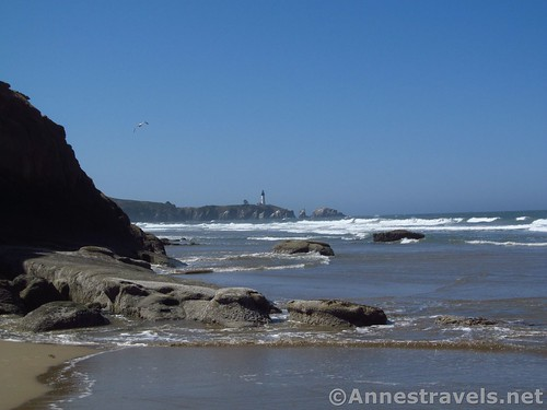 Yaquina Head Lighthouse and volcanic rocks from just north of Schooner Point, Oregon