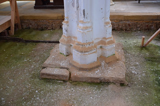 arcade column base with crumbling dust from above
