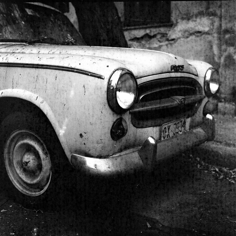 A dirty old car on a damaged old film