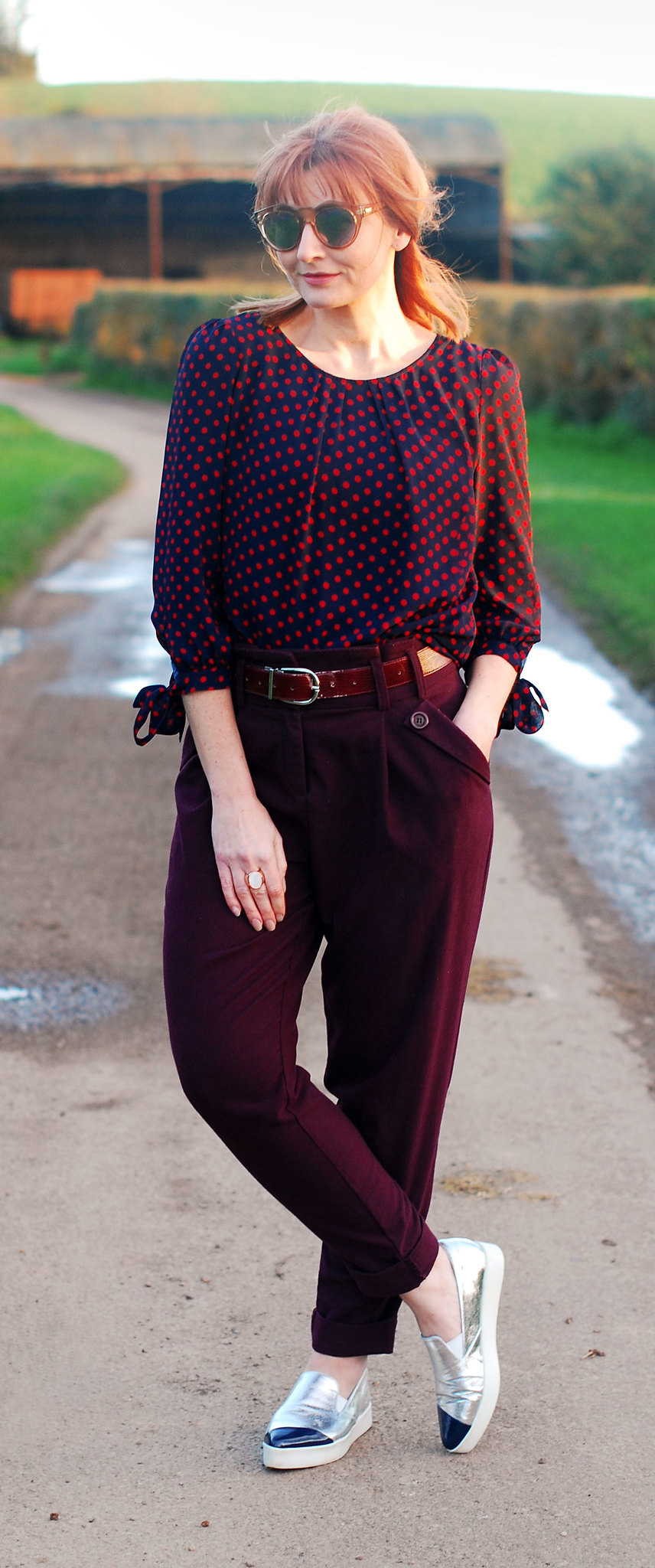 Easy-to-wear colours of plum and navy blue: Red and blue polka dot blouse \ plum peg leg trousers \ silver pointed toe slip trainers | Not Dressed As Lamb, over 40 style
