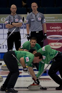 Team Morris in action while Ryan Fry & Brad Jacobs look on | by seasonofchampions