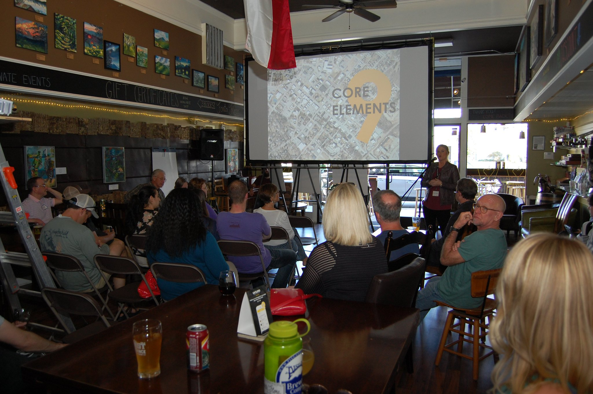 Amanda Morell, Stantec, talks to the crowd gathered for Morganton On Tap held at Brown Mountain Bottleworks Tuesday, March 28, 2017. The next Morganton On Tap will be held Wednesday, May 17, at Catawba Brewing Company.