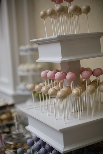 Side view of our tiered stand with pretty shimmery gold cake pops | by Sweet Lauren Cakes