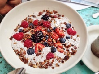 Spiced chia pudding, granola, berries, buckwheat honey, sea salt | by T.Tseng