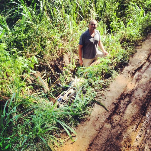 That's Ian. That's my dirt bike upside down. I ended up another 15' from that. That's what Sulawesi mud and taking the wrong course through it can do to you! | by sweetmarias