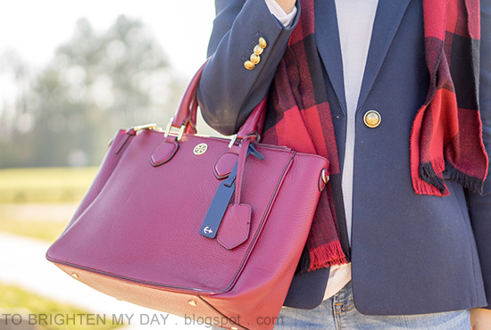 red buffalo check scarf, navy blazer, light pink sweater, burgundy tote with navy anchor luggage tag