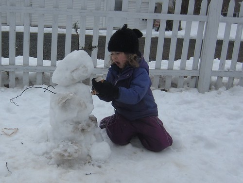 giving the snowman a mouth