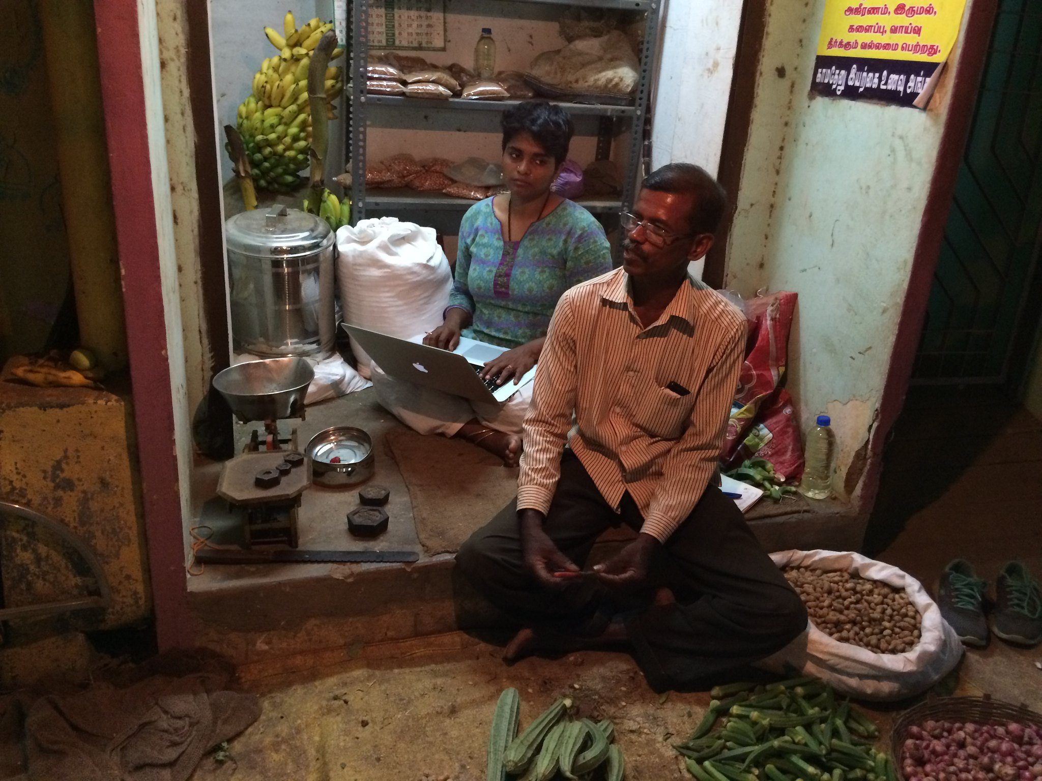 Field Work, interviewing a natural farmer in his shop, while he sells his non-chemical vegetable produce from his small outlet in Tanjavur