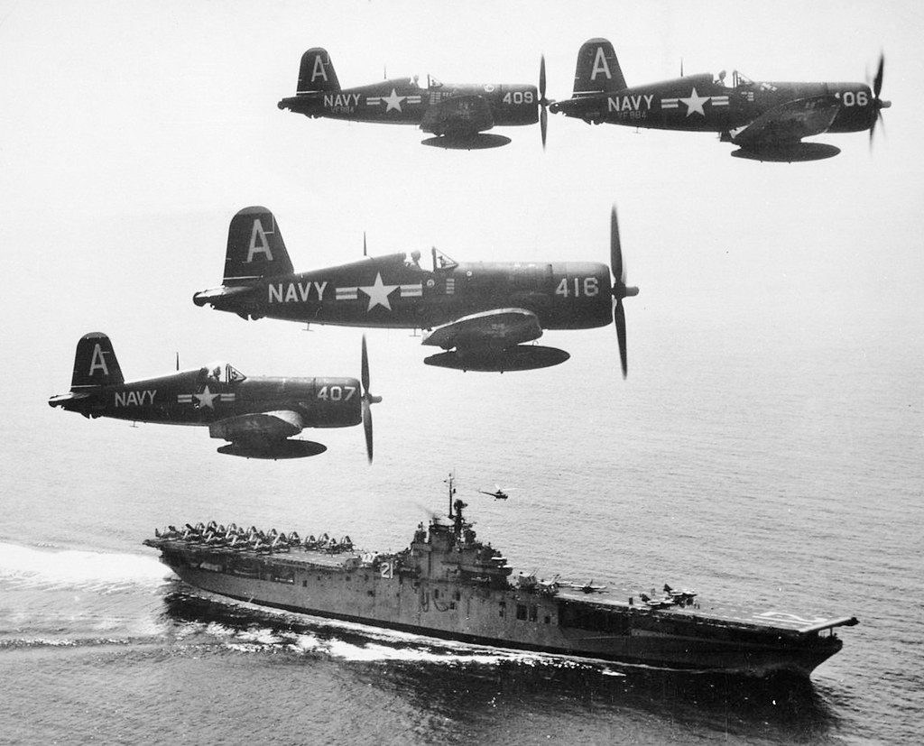 ... VF-884 'Bitter Birds' F4U-4 Corsairs fly past USS Boxer (