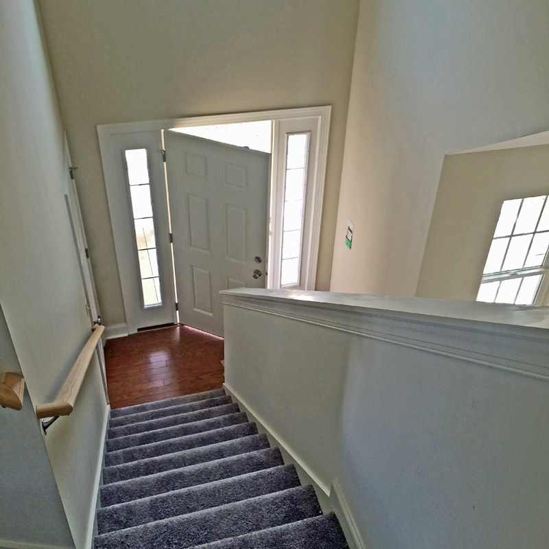 ... Custom Home   Carpeted Stairs, Capped Half Wall | By Schumacher Homes