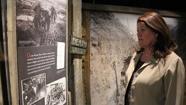 Minister Lori Sigurdson visits the exhibit in Edmonton