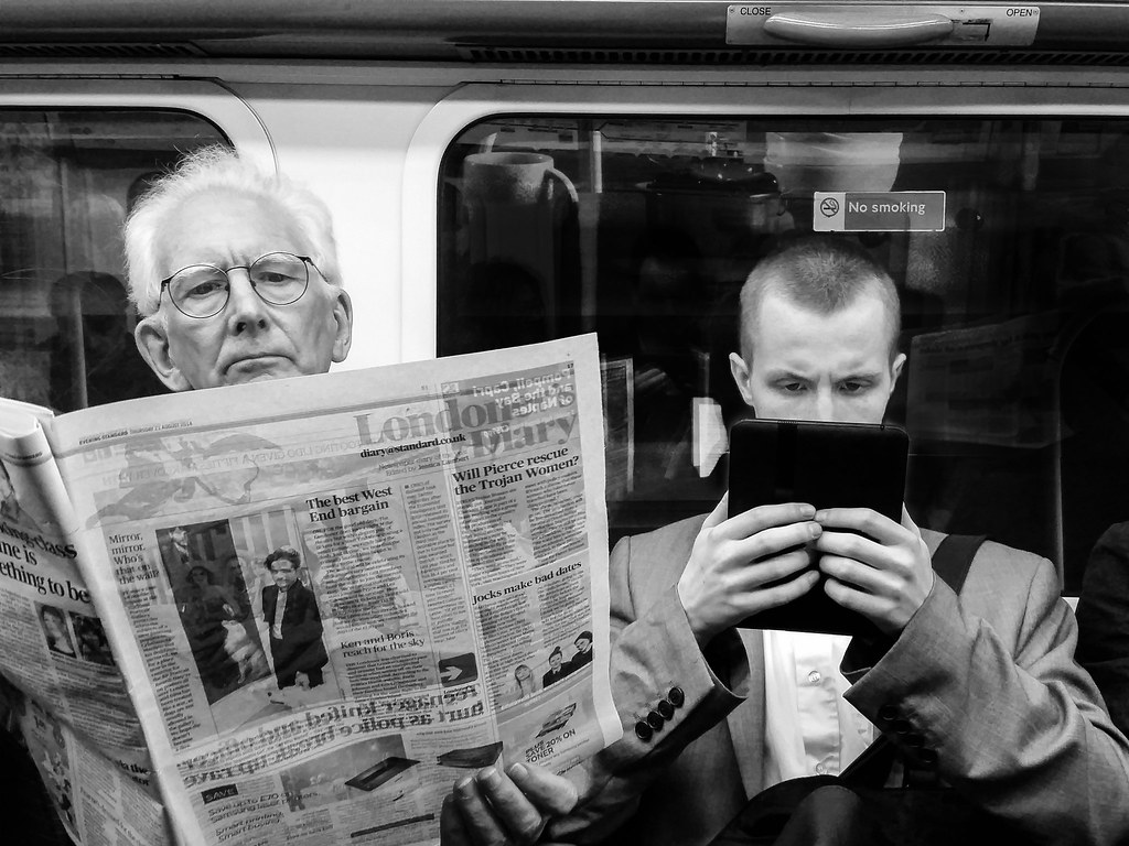 Image result for newspaper reading train
