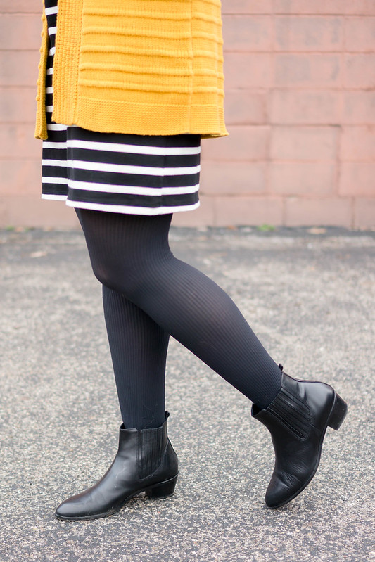 yellow Old Navy cardigan + black and white stripe dress + tights + J.Crew ankle boots + black knot belt | Style On Target blog