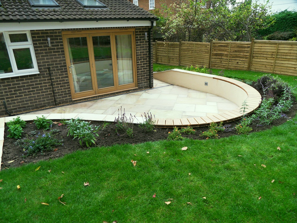 ... Sunken Indian Stone Patio With Rendered Curved Wall And Bespoke Oak  Seat | By Woodlandscapes